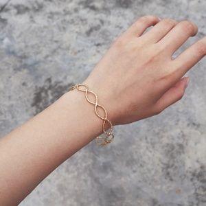 Gold Twisted Metal Circle Bangle Bracelet